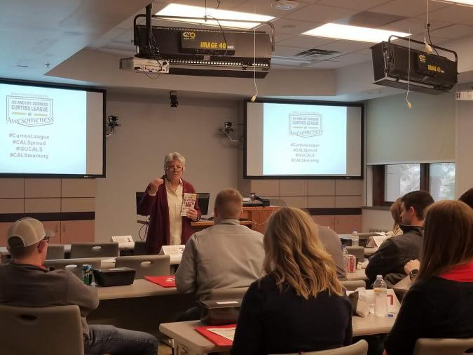 photo of Sue Blodgett presenting to 2019 Curtiss League kick-off attendees