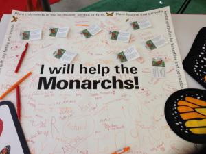 Photo of signatures on poster of people vowing to help monarchs