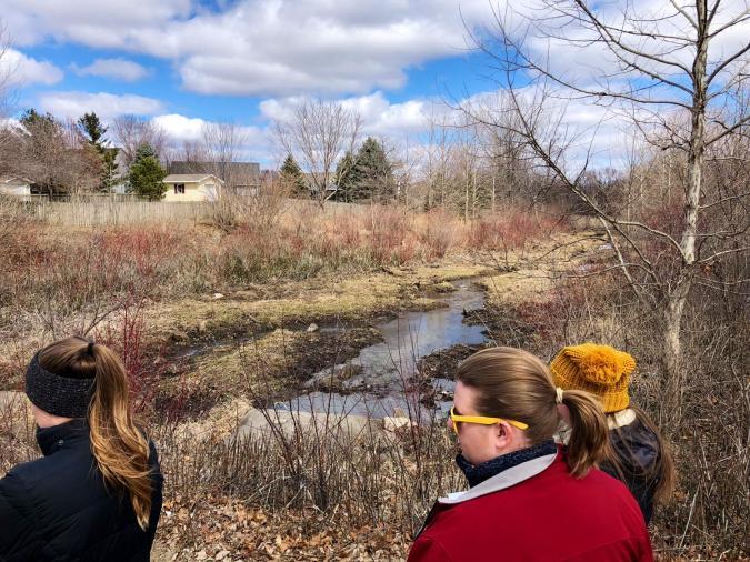 photo of Curtiss League participants touring urban riparian buffer in Ames, Iowa