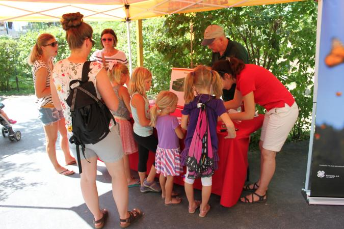 photo of Monarch Festival attendees learning about the monarch life cycle
