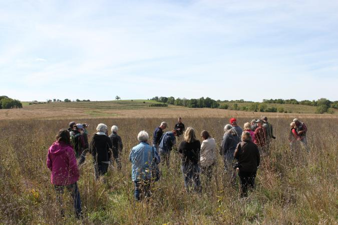 photo of field day participants in native habitat plot